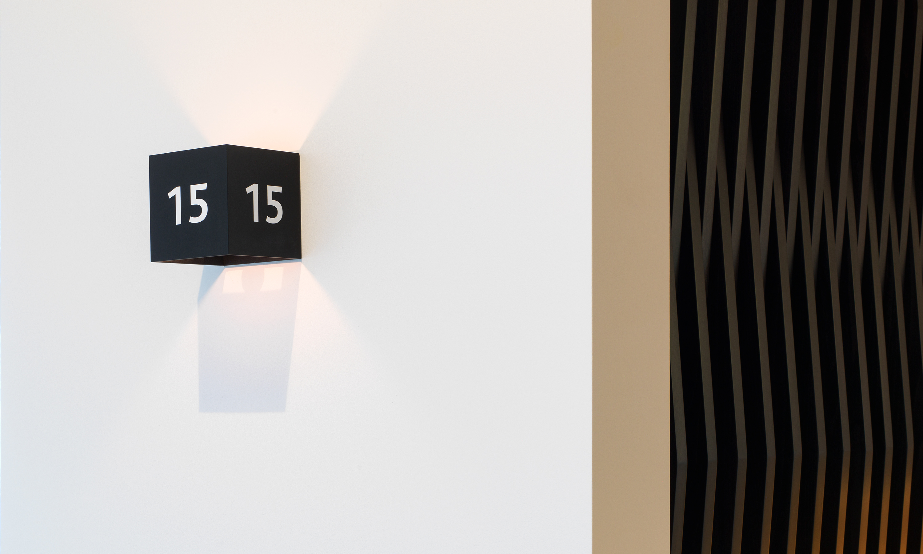 Branding by Neon - Nabarro Law Firm - 125 London Wall Lift Light and room number designed by Dana Robertson