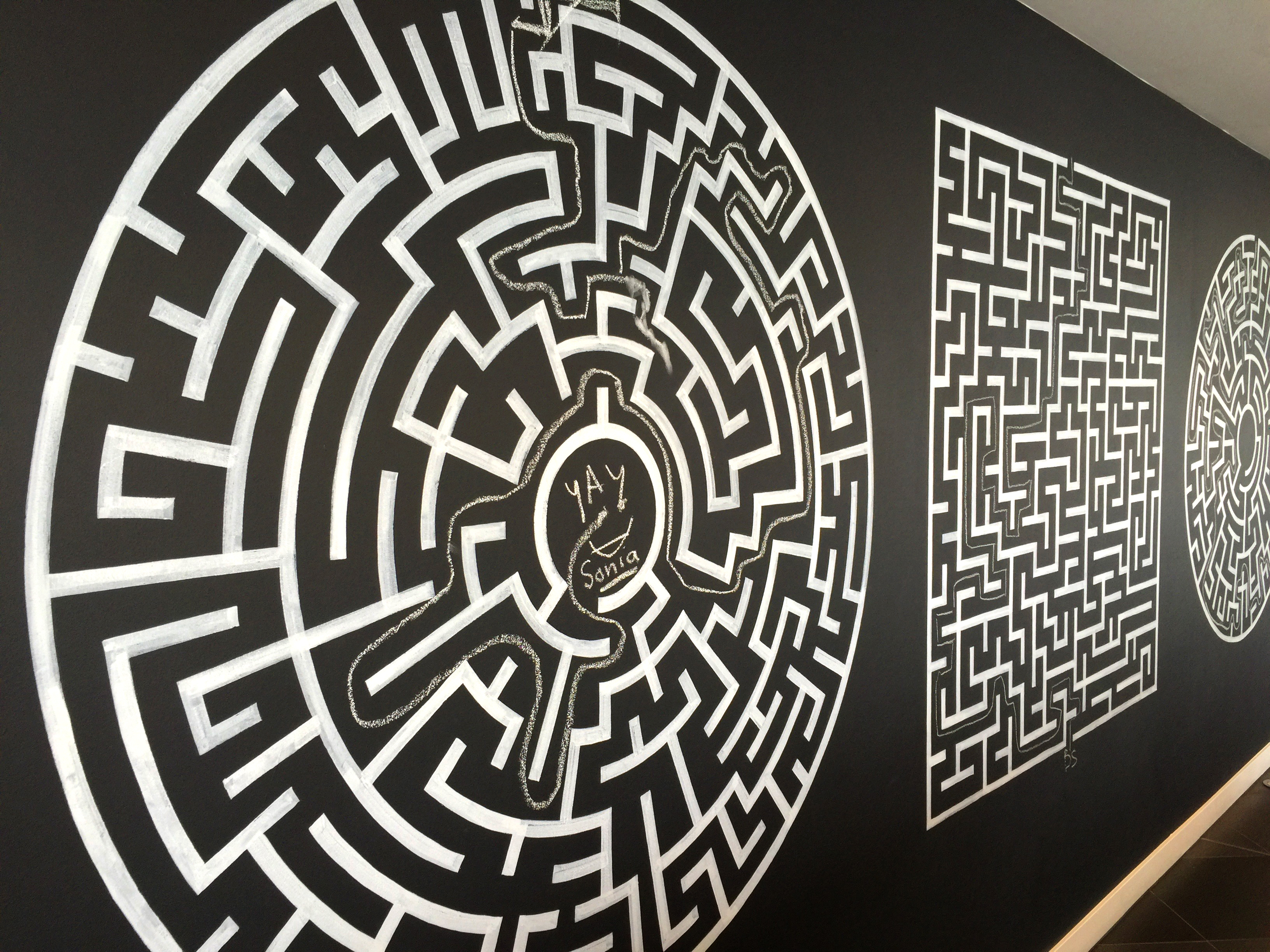 Nabarro LLP canteen wall with six solved mazes