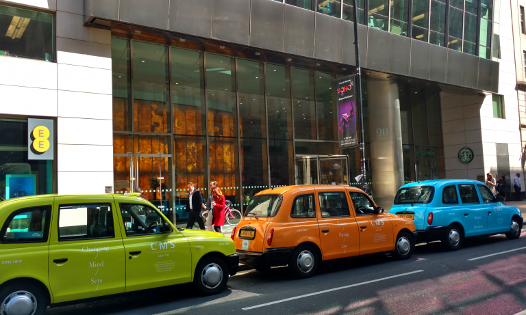 Neon-branding-for-CMS-LLP-taxis-advertising-examples